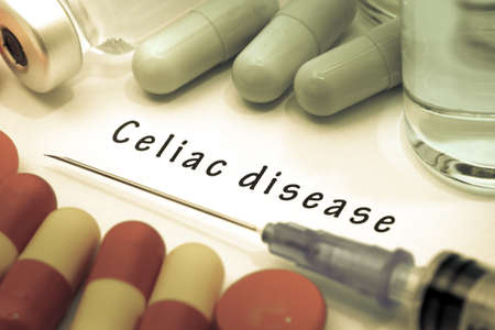 small bowel: Celiac disease - diagnosis written on a white piece of paper. Syringe and vaccine with drugs.