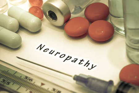 dendrites: Neuropathy - diagnosis written on a white piece of paper. Syringe and vaccine with drugs. Stock Photo