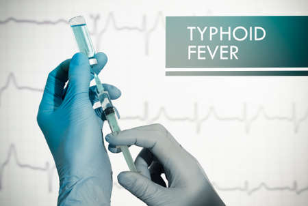typhus: Stop typhoid fever. Syringe is filled with injection. Syringe and vaccine