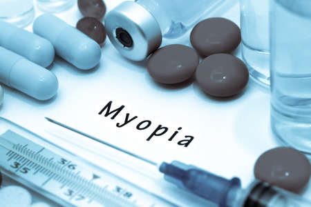 myopia: Myopia - diagnosis written on a white piece of paper. Syringe and vaccine with drugs. Stock Photo