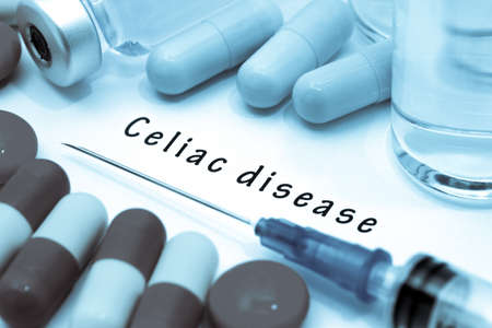 bowel disorder: Celiac disease - diagnosis written on a white piece of paper. Syringe and vaccine with drugs.