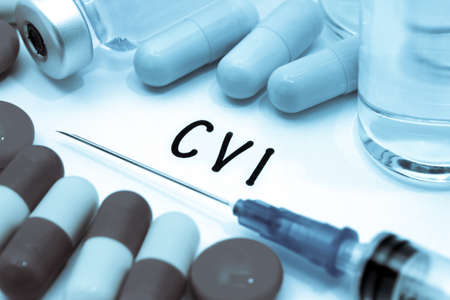 cva: CVI - diagnosis written on a white piece of paper. Syringe and vaccine with drugs.