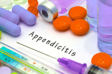 appendix ileum: Appendicitis - diagnosis written on a white piece of paper. Syringe and vaccine with drugs.