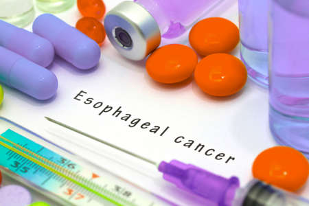 esophageal: Esophageal cancer - diagnosis written on a white piece of paper. Syringe and vaccine with drugs.