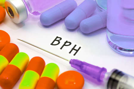 prostatic: BPH - diagnosis written on a white piece of paper. Syringe and vaccine with drugs.