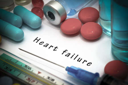 Heart failure - diagnosis written on a white piece of paper. Syringe and vaccine with drugs. Stock fotó