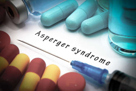 asperger syndrome: Asperger syndrome - diagnosis written on a white piece of paper. Syringe and vaccine with drugs.