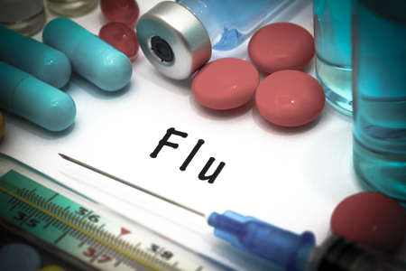 snot: Flu - diagnosis written on a white piece of paper. Syringe and vaccine with drugs.