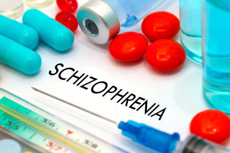 Schizophrenia. Treatment and prevention of disease. Syringe and vaccine. Medical concept. Selective focus Foto de archivo