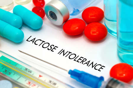 intolerance: Lactose intolerance. Treatment and prevention of disease. Syringe and vaccine. Medical concept. Selective focus