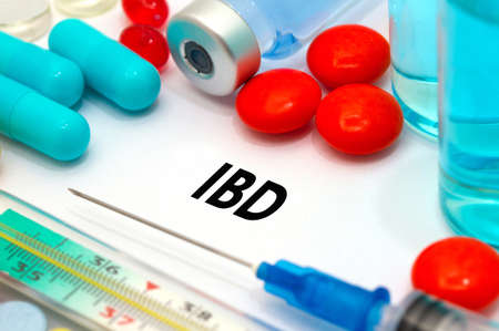 IBD (inflammatory bowel disease). Treatment and prevention of disease. Syringe and vaccine. Medical concept. Selective focus Stock Photo