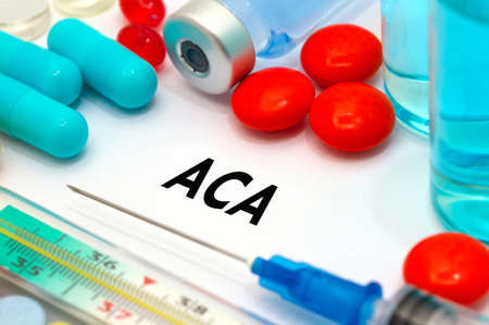 affordable: ACA (affordable care act). Treatment and prevention of disease. Syringe and vaccine. Medical concept. Selective focus