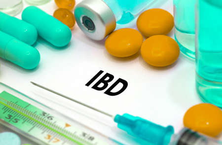 inflammatory bowel disease: IBD (inflammatory bowel disease). Treatment and prevention of disease. Syringe and vaccine. Medical concept. Selective focus Stock Photo