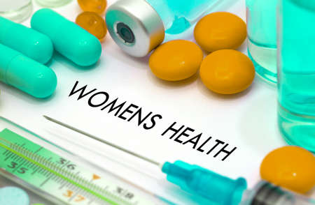 Women's health: Womens health. Treatment and prevention of disease. Syringe and vaccine. Medical concept. Selective focus