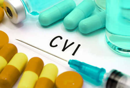 cva: CVI (chronic venous insufficiency) - diagnosis written on a white piece of paper. Syringe and vaccine with drugs. Stock Photo