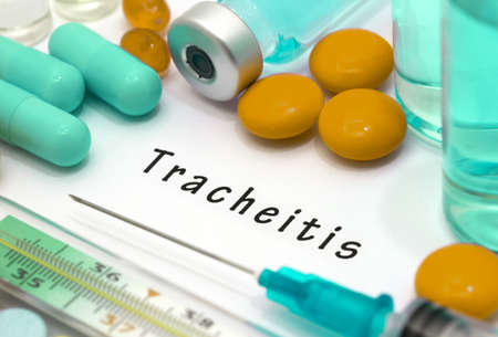 latent: Tracheitis - diagnosis written on a white piece of paper. Syringe and vaccine with drugs. Stock Photo