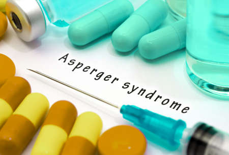 asperger: Asperger syndrome - diagnosis written on a white piece of paper. Syringe and vaccine with drugs.