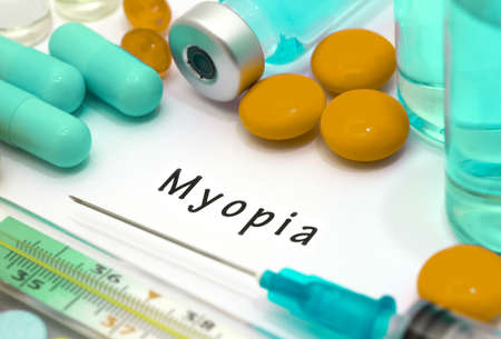 shortsighted: Myopia - diagnosis written on a white piece of paper. Syringe and vaccine with drugs. Stock Photo