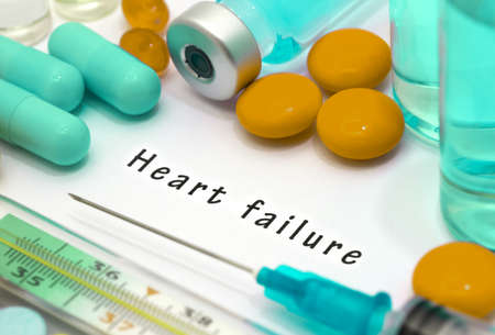 heart failure: Heart failure - diagnosis written on a white piece of paper. Syringe and vaccine with drugs. Stock Photo