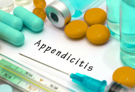 diverticulitis: Appendicitis - diagnosis written on a white piece of paper. Syringe and vaccine with drugs.