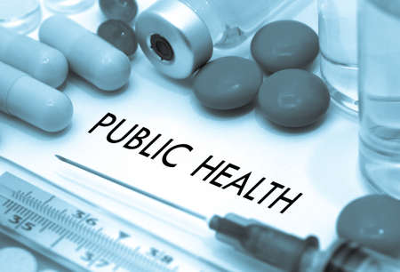 Public health. Treatment and prevention of disease. Syringe and vaccine. Medical concept. Selective focus Stock Photo