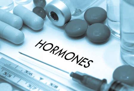 hormonas: Hormones. Treatment and prevention of disease. Syringe and vaccine. Medical concept. Selective focus Foto de archivo