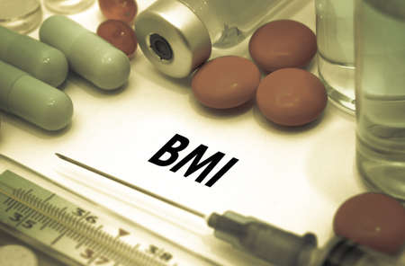 BMI: BMI (body mass index). Treatment and prevention of disease. Syringe and vaccine. Medical concept. Selective focus