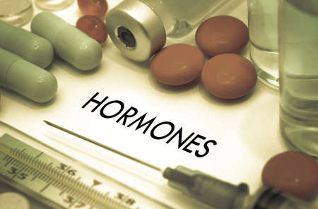 hormones: Hormones. Treatment and prevention of disease. Syringe and vaccine. Medical concept. Selective focus Stock Photo