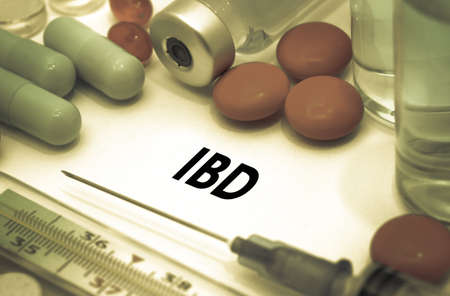 ulcerative: IBD (inflammatory bowel disease). Treatment and prevention of disease. Syringe and vaccine. Medical concept. Selective focus Stock Photo