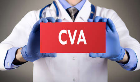 cva: Doctors hands in blue gloves shows the word CVA (Cardio Vascular Accident). Medical concept. Stock Photo