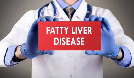 fatty liver: Doctors hands in blue gloves shows the word fatty liver disease. Medical concept.