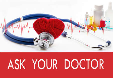 allergy questions: Medical concept, ask your doctor. Stethoscope and red heart on a white background