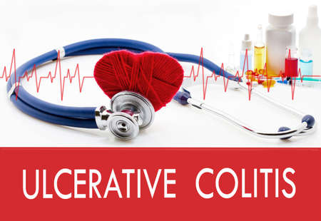 ulcerative: Medical concept, ulcerative colitis. Stethoscope and red heart on a white background