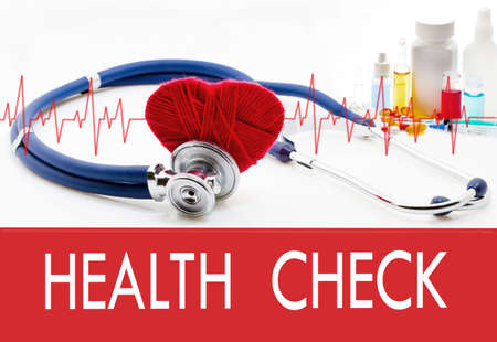 finding a cure: Medical concept, health check. Stethoscope and red heart on a white background Stock Photo