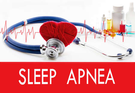 somnambulism: Medical concept, sleep apnea. Stethoscope and red heart on a white background Stock Photo
