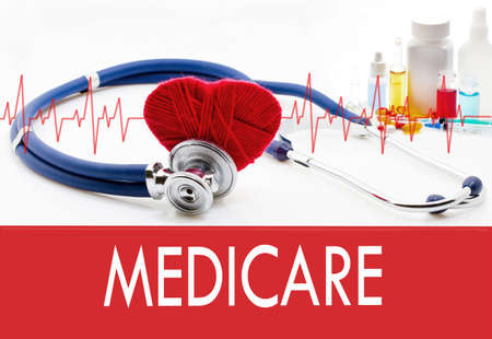 Medical concept, medicare. Stethoscope and red heart on a white background