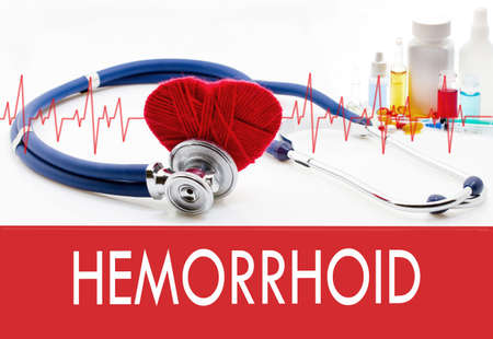 hemorrhoid: Medical concept, hemorrhoid. Stethoscope and red heart on a white background