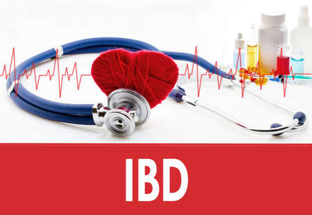 Medical concept, IBD (inflammatory bowel disease). Stethoscope and red heart on a white background
