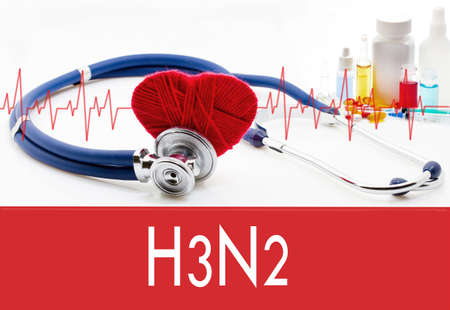 grippe: Medical concept, H3N2 (influenza, grippe). Stethoscope and red heart on a white background Stock Photo