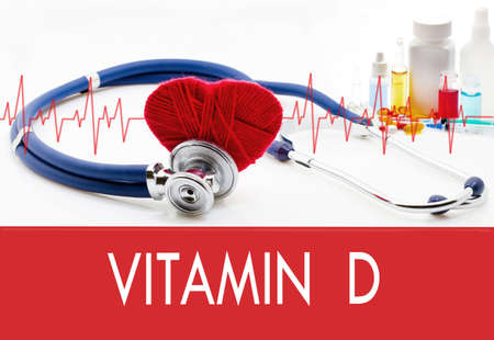 vitamin d: Medical concept, vitamin d. Stethoscope and red heart on a white background