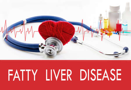 fatty liver: Medical concept, fatty liver disease. Stethoscope and red heart on a white background