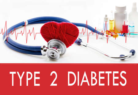 Medical concept, type 2 diabetes. Stethoscope and red heart on a white background