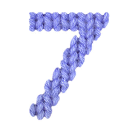 Number 7 (seven) alphabet on a blurry texture knitted pattern of woolen thread closeup. One figure of the alphabet. Education and holidays. Typography design. Color dark blue Stock fotó