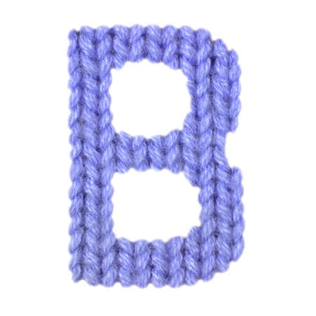 Letter B alphabet on a blurry texture knitted pattern of woolen thread closeup. One letter of the English alphabet. Education and holidays. Typography design. Color dark blue Reklamní fotografie - 68717641