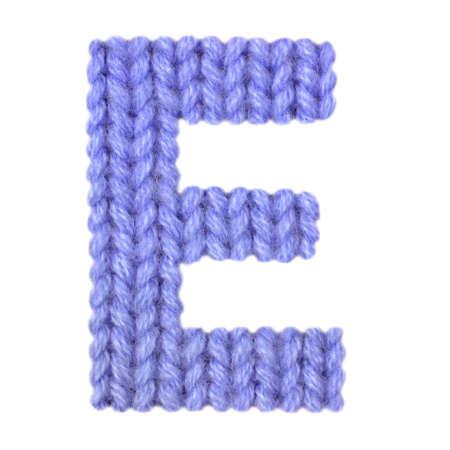 Letter E alphabet on a blurry texture knitted pattern of woolen thread closeup. One letter of the English alphabet. Education and holidays. Typography design. Color dark blue Reklamní fotografie - 68717637