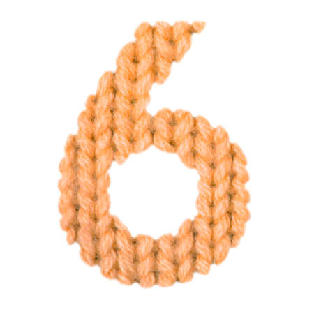 Number 6 (six) alphabet on a blurry texture knitted pattern of woolen thread closeup. One figure of the alphabet. Education and holidays. Typography design. Color orange Standard-Bild