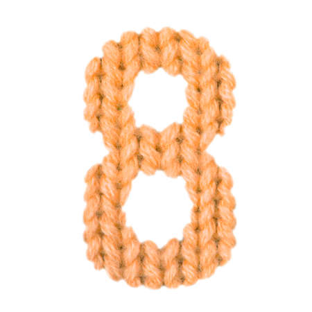 Number 8 (eight) alphabet on a blurry texture knitted pattern of woolen thread closeup. One figure of the alphabet. Education and holidays. Typography design. Color orange Stock fotó