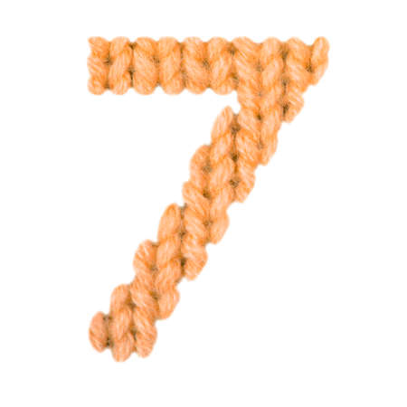 Number 7 (seven) alphabet on a blurry texture knitted pattern of woolen thread closeup. One figure of the alphabet. Education and holidays. Typography design. Color orange Standard-Bild