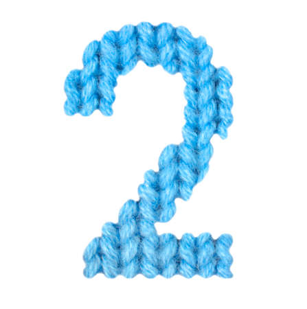 Number 2 (two) alphabet on a blurry texture knitted pattern of woolen thread closeup. One figure of the alphabet. Education and holidays. Typography design. Color blue