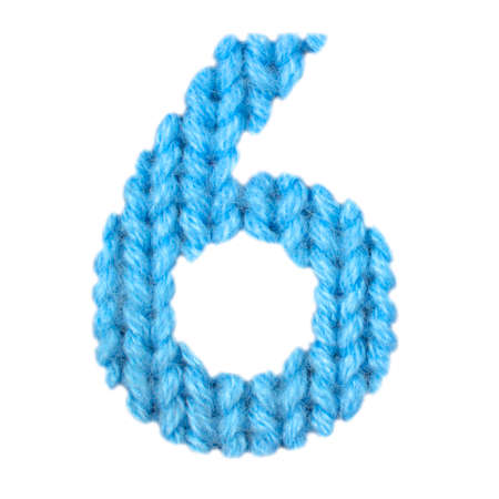 Number 6 (six) alphabet on a blurry texture knitted pattern of woolen thread closeup. One figure of the alphabet. Education and holidays. Typography design. Color blue